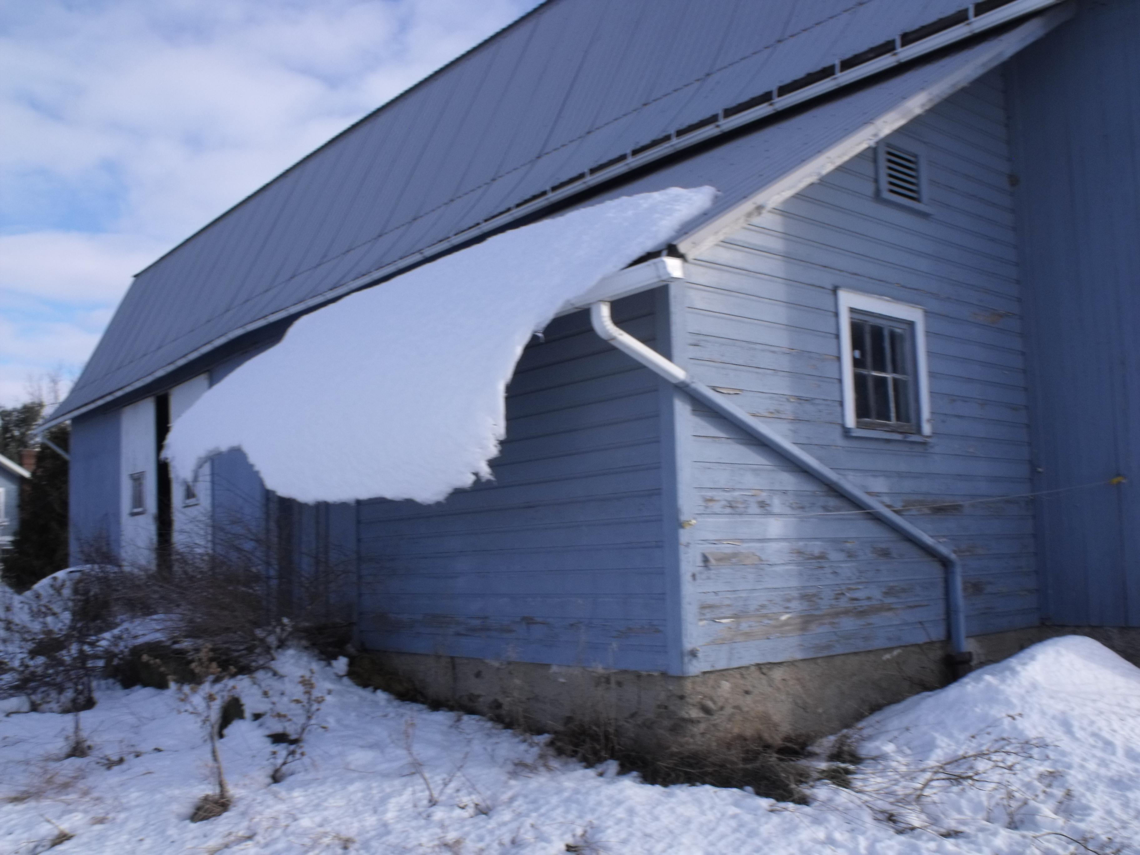 horse barn with melting snow